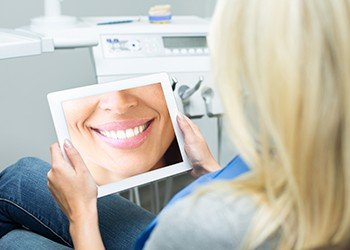 Woman looking at her virtual smile design images